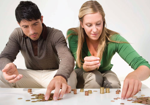 young adult male and female couple working together to count change